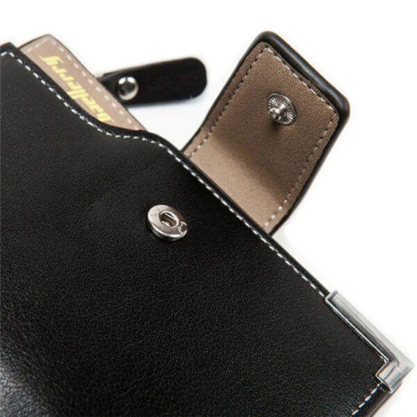 Foto de de billetera de bolsillo elegante con monedero de cuero PU mostrando su broche principal en color negro