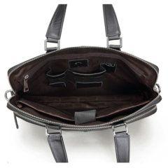 Foto de maletín clásico urbano ejecutivo de cuero natural mostrando vista interior en color negro