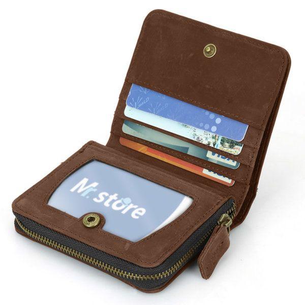 Foto de billetera vertical vintage bifold con cierre de cuero natural mostrando su vista interior de tarjeteros en color marrón