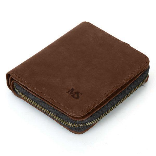 Foto de billetera vertical vintage bifold con cierre de cuero natural mostrando una vista diagonal en color marrón