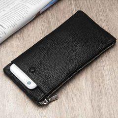 Foto de billetera larga con cierre y portacelular mostrando bolsillo en color negro