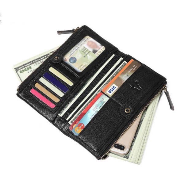 Foto de billetera larga clásica con doble cierre de cuero natural mostrando capacidad de almacenamiento en color negro
