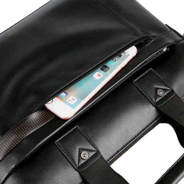 Foto de morral maletín elegante ejecutivo de cuero pu mostrando detalle de cierre frontal en color negro