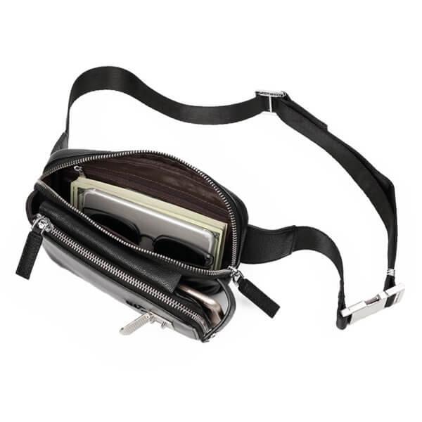 Foto de canguro clásico urbano de cuero natural mostrando vista de capacidad de bolsillo en color negro