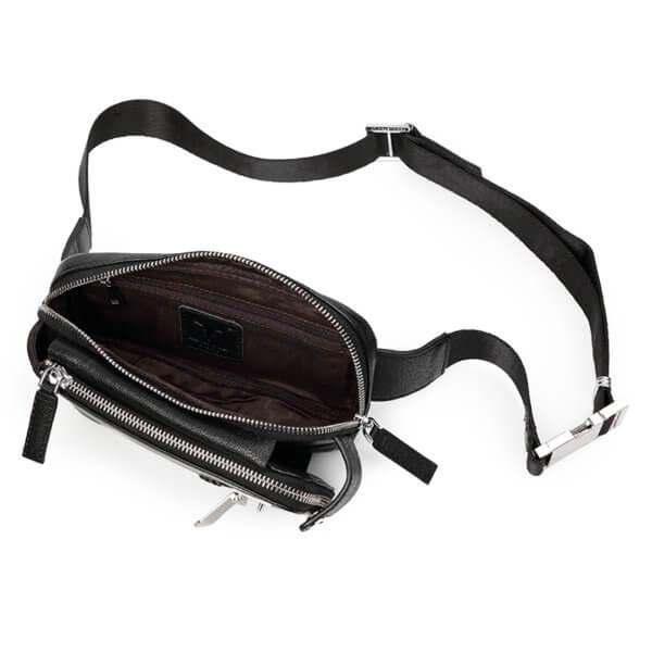 Foto de canguro clásico urbano de cuero natural mostrando vista interior de bolsillo principal en color negro