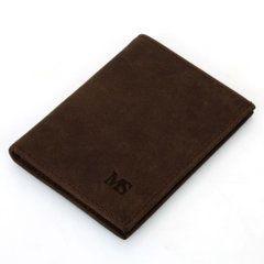 Foto de billetera vertical vintage minimalista de cuero natural mostrando una vista diagonal en color café