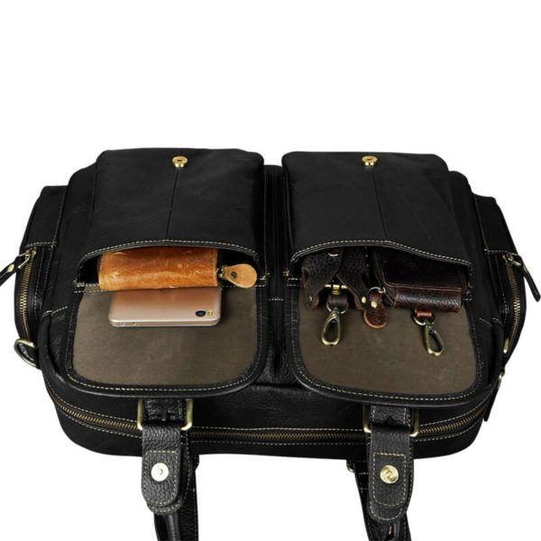 Foto de maletín morral clásico urbano viajero de cuero natural donde se muestra una vista de la capacidad exterior de sus bolsillos en color negro